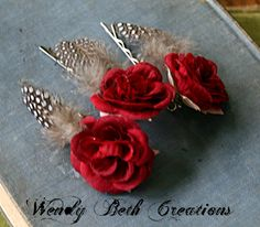 Add a little romance to any hair style! Pin back a few wispy hairs or tuck along side a french twist.    Miniature red roses with a rhinestone