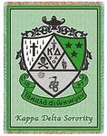 "Our Kappa Delta Afghan is an elegantly woven sorority throw and measures 48""x68"".  It also carries the Kappa Delta Greek letters and crest. A distinctive gift for a new active or loyal alum! Washable. Available in many Fraternity"
