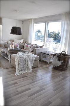 Light Wood Floors And White Curtains