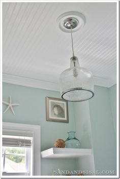 The first thing we did was Install a Bead Board Ceiling and crown molding. It added instant character! Then we installed this beautiful seeded glass pendant fixture from Ballard Designs. You can read my tutorial How to Install a Light Fixture to see how manageable it can be.