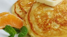 Fluffy pancakes made with homemade soured milk taste like cake and are best served with butter, syrup, and whipped cream.
