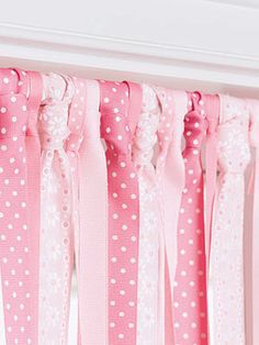 Cute Curtains, or Doorway, or Closet! Tension rod plus about 10 yards each of five different ribbons (amount will vary). Cut the ribbon a few inches longer than you need in order to reach the sill, then tie each length onto the rod in a necktie knot. Alternate colors or patterns. Trim to fit.