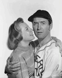 Medium publicity shot of smiling June Allyson as Ethel embracing James Stewart as Monty Stratton, wearing baseball uniform.