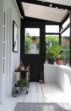 See how I gave our tired old sunroom a fresh botanical scandi garden room makeover, transforming it from a boring magnolia box into a minimalist sunroom with painted black window frames and white brick walls, looking out onto our garden. Building A Porch, House Design, Garden Room, House With Porch, Sunroom Decorating, House Interior, Home, Nordic Interior, House