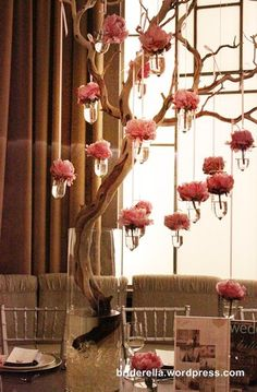 I love this branched tree centerpiece with hanging flowers in little vases. http://www.mybigdaycompany.com/