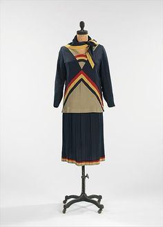 This day dress encompasses the spirit of the modern woman.  The 1920s were a liberating decade, as women became more independent, changing their role in society.