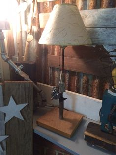 Upcycled Old Fishing Pole Lamp by CajunCustomCrafted on Etsy Fishing Pole Craft, Fishing Poles, Fishing Shack, Pole Lamps, Woodworking Lamp, Rustic Cabin Decor, Industrial, Cool Lighting, Lights