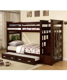 This stylish bed features a solid stairwell that makes it easier to reach the upper bunk and sleek drawers for storage below. Bunk beds are a classic part of childhood like riding bikes and stories around the campfire. The double layer bed not only opens up more floor space for play, but is perfect for sibling bonding and sleepover parties. This classic trundle bed offers even more sleeping room!  •98'' W x 68'' H x 43'' D •Mattress not included • Maximum weight capa...