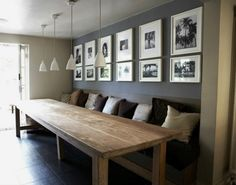 Perfect Large dining table with a built in bench and wall behind decorated with pics The post Your Fresh Dose Of Inspiration For New Dining Room Décors appeared first on Interior Designs . Grande Table A Manger, Banquette Seating, Dining Room Banquette, Dining Chair, Beautiful Dining Rooms, Built In Bench, Minimalist Decor, Minimalist Interior, Minimalist Living