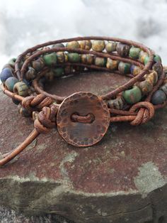 triple wrap bracelet  FAST and FREE by offbeadinpathneosho on Etsy, $48.00 •Materials: brown leather cord, czech beads, picasso beads, copper button, hammered copper, rustic beads, off the beadin path neosho, distressed brown supple leather, hammered copper button, rustic czech glass beads
