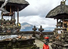photo @lucalocatelliphoto every time I come back to Indonesia I never missed to travel around Bali. One amazing place is the central mountains where volcanoes and small villages are the only things you see.  Here is a small family Hindu temple in front of the Gunung Batur a particular active volcano with two calderas one inside the other. The peak reach 1717 meters. The last big eruption was in 1963. At the feet of the volcano there's the lake Batur. #Bali #indonesia #travel #volcano…