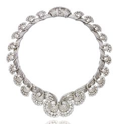 AN ART DECO DIAMOND NECKLACE, BY RENÉ BOIVIN  -  Designed as a series of graduated baguette and brilliant-cut diamond scrolls, each element detachable to form a tiara, a pair of ear clips, a bracelet or a pair of brooches (fittings missing), mounted in platinum, 1935.