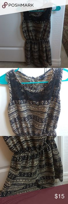 Patterned Romper Gathers at waist. Lace pattern on top front (near collar bone). Button clasp on the back. Other