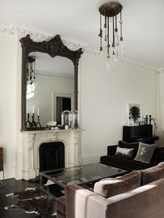 Est Magazine #4 Mirror over fireplace Chandelier canopy