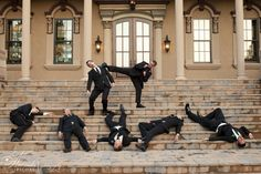 Recreation of a photo from the bride's parents wedding (dad owns a karate studio!) Groom knocks out all of his groomsmen!