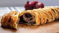 This is either a poor man's Wellington, or a posh sausage roll, depending on how you look at it. It's certainly good enough for a special meal. The sausage filling is spiked with black pudding, enhanced with a savoury mushroom base and topped with caramelised onions. Wrapped in crisp, buttery 'plaited' pastry, it looks really impressive but is easy to make.