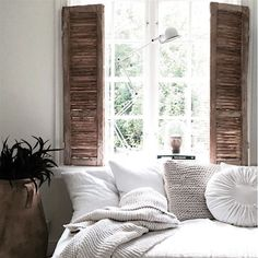 Wooden shutters completely change the feeling of a bedroom. Rustic luxe!