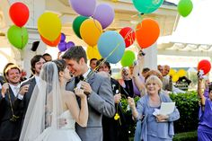 Unique Ceremony Celebrations  In lieu of having a receiving line or rice toss, this couple took a group photo with all of their guests, in which each person held a colorful balloon.