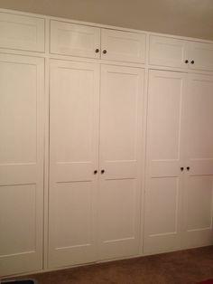 Shaker style wardrobe doors for built in wardrobes across the width of a bedroom www.bmc-construction.co.uk
