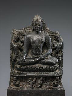 Seated Buddha Reaching Enlightenment, Flanked by Avalokitesvara and Maitreya, late 10th–11th century. India, Bihar, Nalanda monastery. The Metropolitan Museum of Art, New York. Rogers Fund, 1920 (20.58.16) | This delicately-carved Buddha from Nalanda is shown siting in a yogic posture, deep in meditation, at the very moment of his enlightenment. His right hand reaching down to touch the earth, bearing witness to the past actions that brought him to this point of ultimate realization…