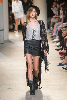 Metallic lace-up tank, black lace shrug and leather mini skirt combo at Zadig & Voltaire. #pfw #ss14
