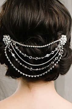 Great Gatsby Style at it's finest...The Angela hair swag is inspired by the roaring 20's with stunning Swarovski crystals draping beautifully across the back of your head. #weddingaccessories #hairstyles
