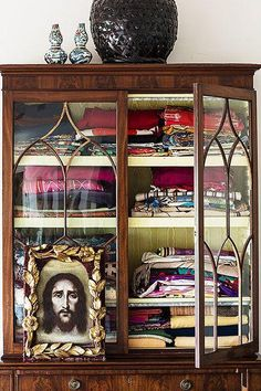 A china cabinet can hold far more than tableware — like colorful textiles collected from years of travels.
