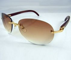 af1a0200dc6 Cartier 3524016 Wooden Sunglasses In Gold with Brown lens
