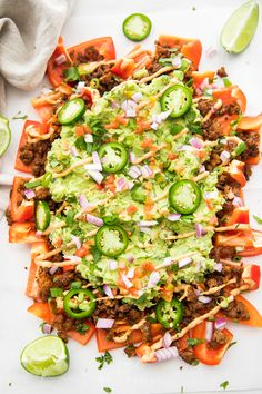 Bell Pepper Nachos Crisp slices of bell pepper loaded with traditional nacho toppings like seasoned ground beef, guacamole, and chipotle aioli. Totally compliant and paleo, too. Top with my vegan queso if you're feeling extra! Paleo Recipes, Mexican Food Recipes, Dinner Recipes, Cooking Recipes, Paleo Food, Paleo Whole 30, Whole 30 Recipes, I Love Food, Good Food