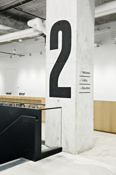 Image 16 of 18 from gallery of Nike New York Headquarters / WSDIA   WeShouldDoItAll + STUDIOS Architecture. Photograph by Floto+Warner Office Signage, Wayfinding Signage, Signage Design, Floor Signage, Directional Signage, Environmental Graphic Design, Environmental Graphics, Corporate Design, Industrial Signage