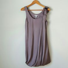 {H&M} Silky Sleeveless Shift Dress -Outer: 100% polyester -Lining: 100% polyester  -Bubble style bottom -Color is more grey/taupe than how it turned out in the pictures. (With a slight purple undertone.) *H&M sizes run small H&M Dresses Midi