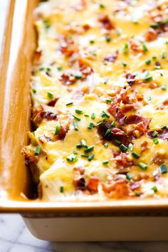 Loaded Scalloped Potatoes... Bacon, sour cream, cheese, chives and all your favorite baked potato toppings come together for one unforgettable side dish! This will become a family favorite!