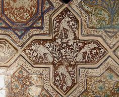Cross-Shaped Tile Object Name: Cross-shaped tile Date: 13th century Geography: Iran, probably Kashan Culture: Islamic Medium: Stonepaste; inglaze painted in blue and turquoise and luster-painted on opaque white glaze Dimensions: 8 in. (20.3 cm) Wt. (whole group) 31 lbs. (14.1 kg) Classification: Ceramics-Tiles Credit Line: H.O. Havemeyer Collection, Gift of Horace Havemeyer, 1941 Accession Number: 41.165.33