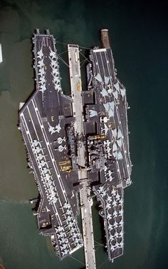 """Birdseye view of carriers USS and USS moored beside each other at Pearl Harbor on 23 Aug Midway en route from Yokosuka, Japan, to NAS North Island where it was decommissioned on 11 Apr Independence continued to Yokosuka"""