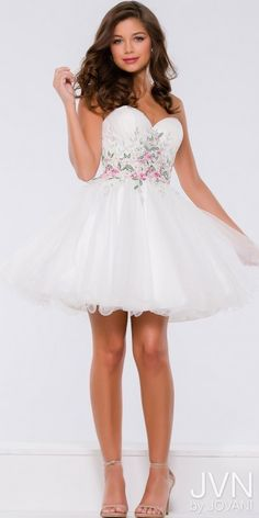 f1beb07374 Keep it short and sweet in the Embellished Floral Applique Tulle Homecoming Dress  from JVN by Jovani. This adorable dress features a fitted bodice with a ...