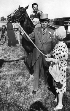 Owner E.P. Taylor and his wife Winnifred lead Northern Dancer, with Bill Hartack aboard, to the winner's circle after the Queen's Plate on June 20, 1964.