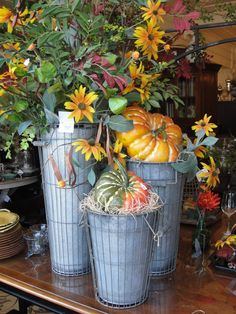 Simple fall flowers and pumpkins in really cute galvanized/wire containers...where can I get those containers???