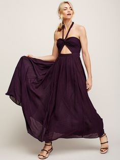 Twist and Shake Midi   Made from our crinkly and gauzy Endless Summer fabric, this easy and effortless midi dress features V straps at the bust, a cutout accent at the waist and hip pockets. Smocked elastic band in back and adjustable halter straps.