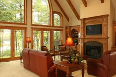This spacious living room is in a custom built lake home in Eagle River, WI. Custom cabinets and fireplace are on the right hand wall. With large custom Kolbe & Kolbe windows facing the lake. As with most custom homes a client and builder relationship is always important to bring the whole project together.