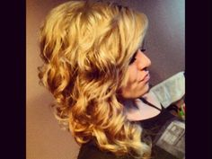 Evening out? Tight blonde waves have a romantic look.