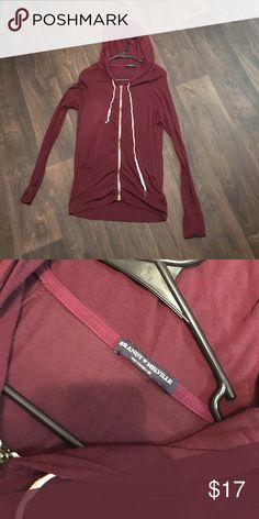 Brandy Melville maroon thin zip up very comfy and great for lounging days! it's as thin as a regular tee but is zip up. very nice for summer or casual wear. one size fits all, very soft Brandy Melville Tops Tees - Long Sleeve