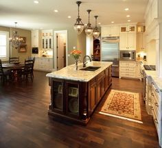 Kitchen lighting needs: white granite, cherry cabinets for the island and w Kitchen Redo, New Kitchen, Kitchen Design, Kitchen Ideas, Kitchen Dinning, Kitchen Layout, Design Seeds, Beautiful Kitchens, Cool Kitchens