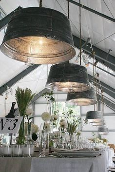 green house wedding; Galvanized bucket lights; all white linens and flowers