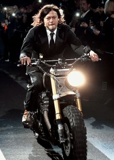 Norman Reedus rides into Madison Square Garden on Daryl's motorcycle at The Walking Dead season 6 fan premiere event on October 9, 2015 in New York City