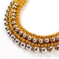 Macrame jewellery made using silk cord.