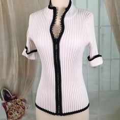 Belldini White Short Sleeved Knit Top This is a super cute knit top with a fun diamond like zipper front.  Has a small stain on the inside back but you can not see it from the outside. Size L. Belldini Tops