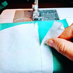 Use tissue paper to stabilize your knit fabric and get even and nice stitches.