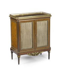 A fine Louis XVI style gilt bronze mounted burl, yew and kingwood bibliothèqueHenry Dasson dated  1879