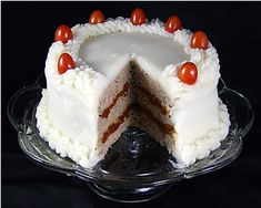 Meatloaf Cake with mashed potato frosting and cherry tomatoes as garnish.