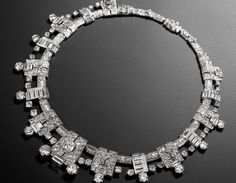 An impressive art deco diamond necklace, by Cartier, circa 1936 The highly articulated collar composed of pierced geometric plaques, graduating in size from the centre and pavé-set throughout with old brilliant, brilliant, single, square and baguette-cut diamonds, diamonds approximately 37.65 carats total, signed Cartier Paris, maker's mark, French assay marks.